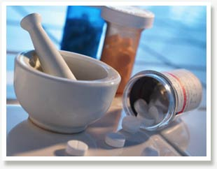 Bowl and pestle with pill bottles