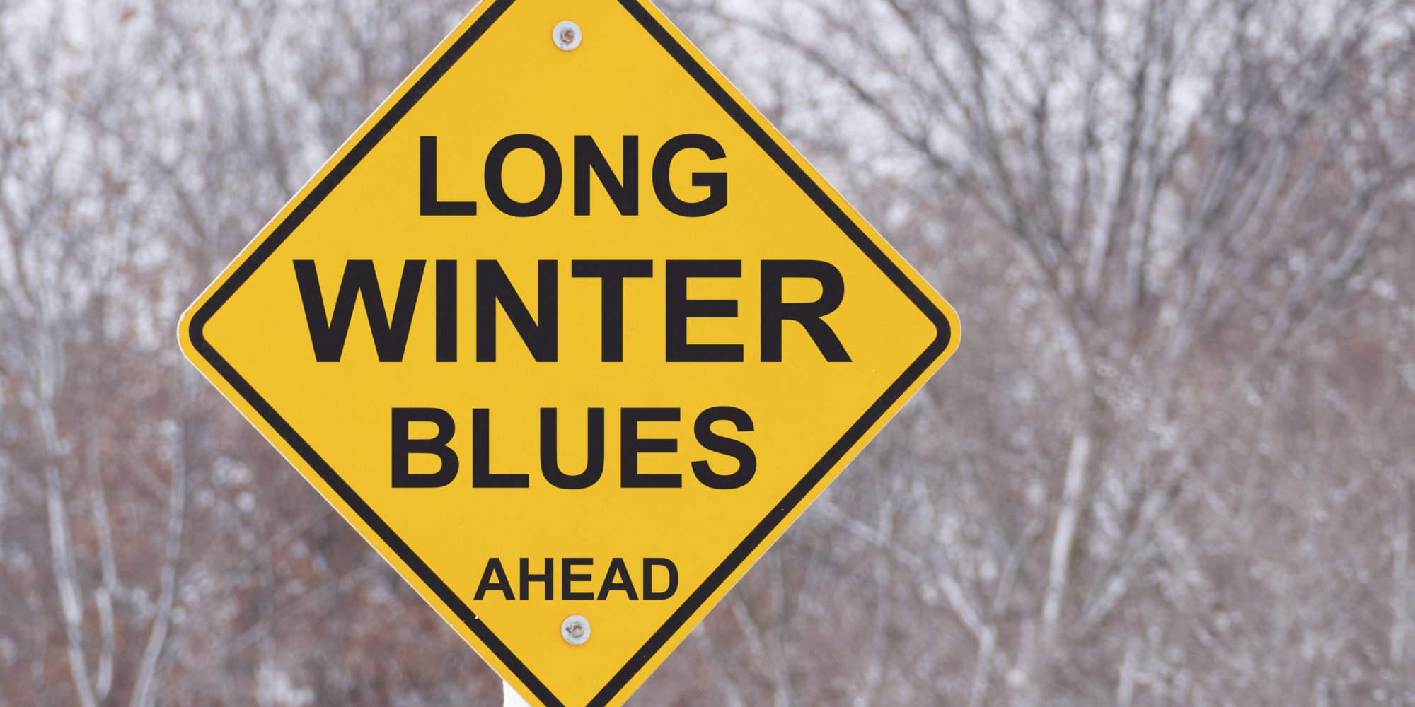 Winter Blues Ahead sign in winter scene
