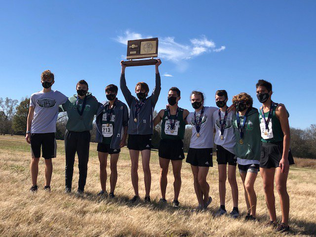 Free State High School boys cross country team lifts 6A state championship trophy