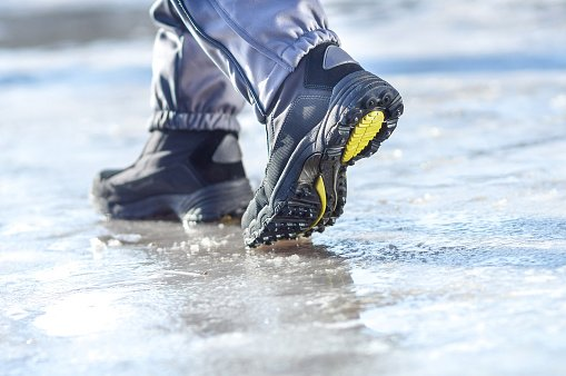 Feet walking on ice