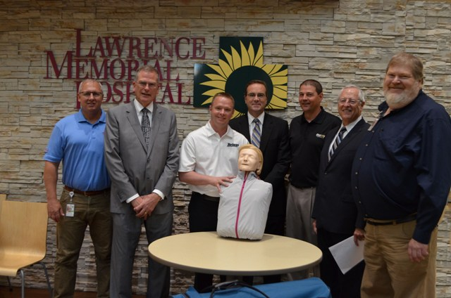 Scott Dieker, LMH Community Education; Lawrence New Car and Truck Dealers participating in the presentation of the Resusci Anne CPR units to the LMH Education Department are (L to R):  Gary Bennett, Laird Noller Automotive; Will Thompson, Briggs Auto Group; Greg Maurer, Dale Willey Automotive; Randy Habiger, Crown Toyota of Lawrence; and Dale Willey, NADA Charitable Foundation Board of Directors and John Drees, LMH Community Education