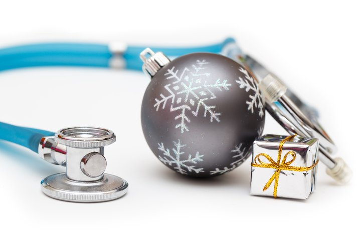 Photo of stethoscope, package and silver ball