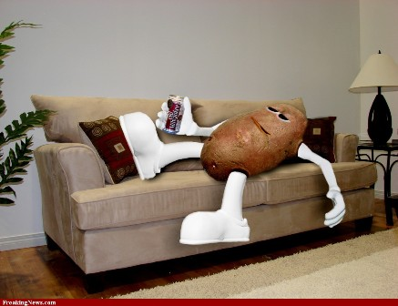 A potato with arms and legs laying on a couch